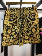 Versace 2019ss latest black gold baroque print beach shorts