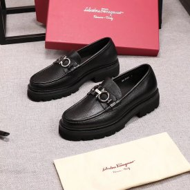 Ferragamo a man's shoe with a thick sole