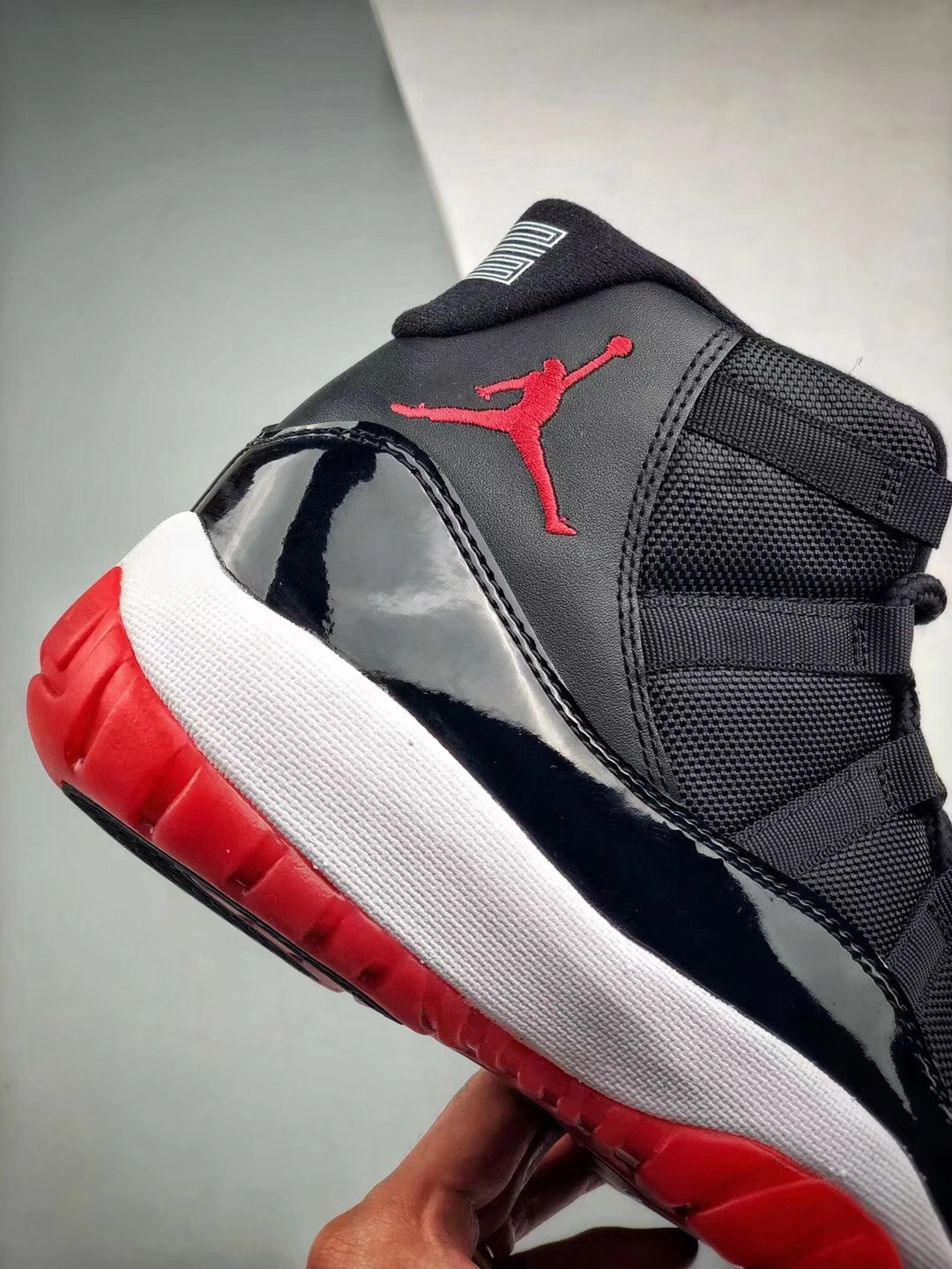 e1ed2df177f8 Air Jordan Retro 11 Bred Basketball Shoe