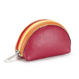 The new first layer cowhide contrast color fashion zipper mini coin purse headphone bag