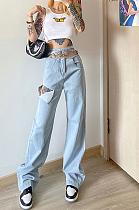 High-waisted lace-up jeans are ripped and loose, slimming straight leg jeans