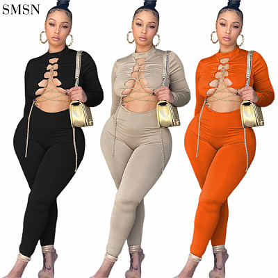 New Arrival 2021 Fall Jumpsuits Fashion Solid Color Cutaway Neck And Chain Cross Tights Jumpsuit