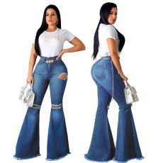 Fashionable skinny jean bellbottoms with holes in knees