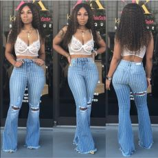 Jeans flared pants with holes in the knee