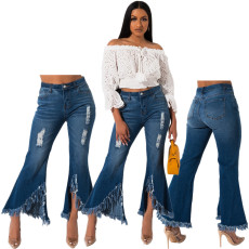 Fashionable flared jeans with fringes and holes