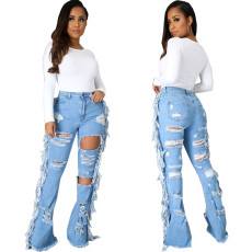 Sexy fashion tassel hole elastic slim flared pants