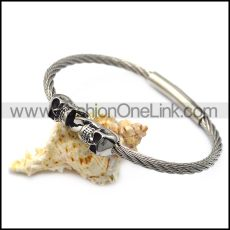 silver stainless steel two skulls wire bangle b007543